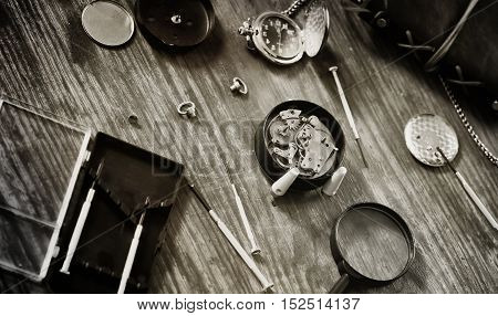 Workshop watch repair man in the course of work
