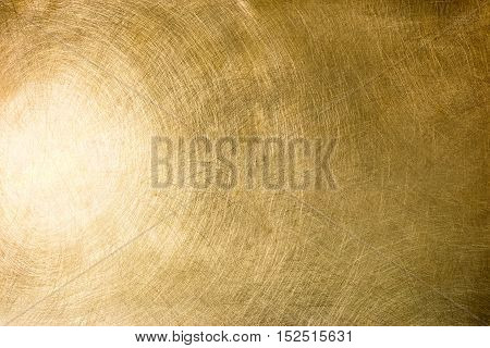 Brushed Brass Plate With Multiple Scratches And Light Reflection