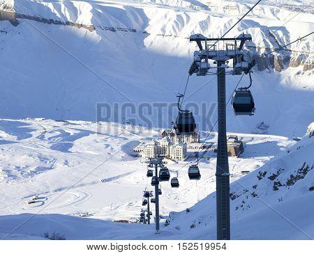 Gondola Lift On Ski Resort At Winter Sun Evening