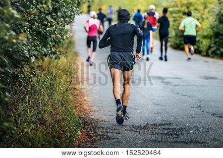 male runner of average years running marathon in fall city Park