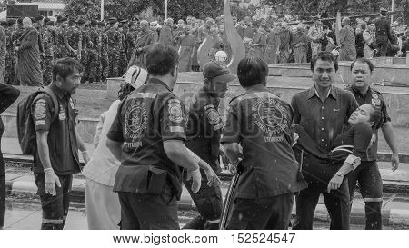 KRABI THAILAND - OCTOBER 19 2016: Thai Krabi official faint during pay respect to the deceased King Bhumibol Adulyadej at Krabi Provincial Hall on October 19 2016 in Krabi Thailand.