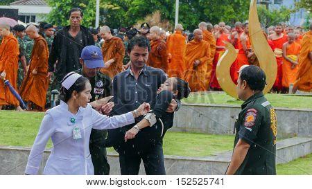 KRABI THAILAND - OCTOBER 19 2016: Thai woman faint during Mourning Ceremony of King Bhumibol Adulyadej at Krabi Provincial Hall on October 19 2016 in Krabi Thailand.