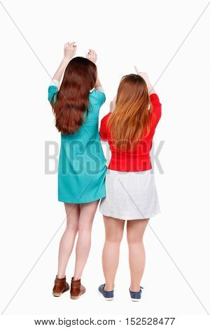 Back view of dancing two women. Dance party. backside view of person.  Rear view people collection. Isolated over white background. Two young girls at the disco.
