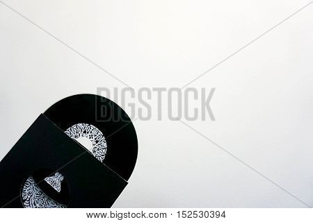 Isolated black CD rom with package on the left of the photograph