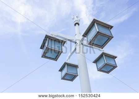 uprisen angle of square lamppost with the clear blue sky