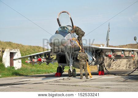 Vasilkov Ukraine - August 3 2012: Ukrainian Air Force Mig-29 fighter plane is being prepared for a training flight with weapons