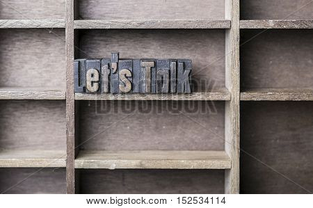 old wooden printers type forming the word Letâ??s Talk