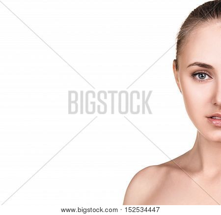 Half-face portrait of beautiful sensitive woman with copy space on white background