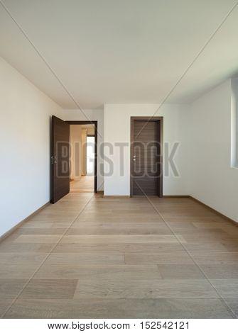 Interior of empty apartment, wide room with wooden floor