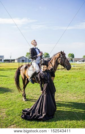 Learning how to ride a horse whilst wearing formal traditional clothing