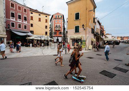 Rovinj, Croatia - July, 2016 - People walk in the center of the historic town of Rovinj, Croatia.