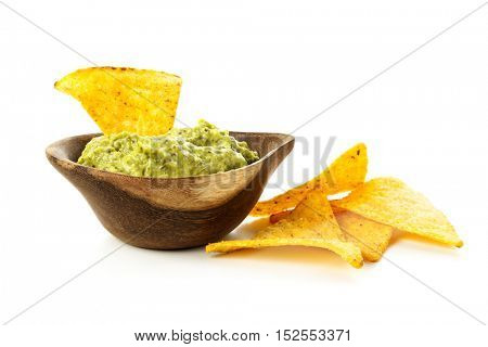 Tortilla chips. Wooden bowl of Guacamole with nachos isolated on white background