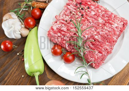 Raw fresh ground beef meat - minced meat on plate