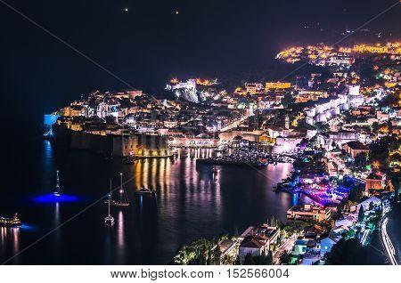 Stunning panorama of Dubrovnik at night with old town and Adriatic sea,Dalmatia,Croatia,Europe