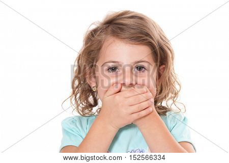 Little girl keeps her mouth shut. All on white background.