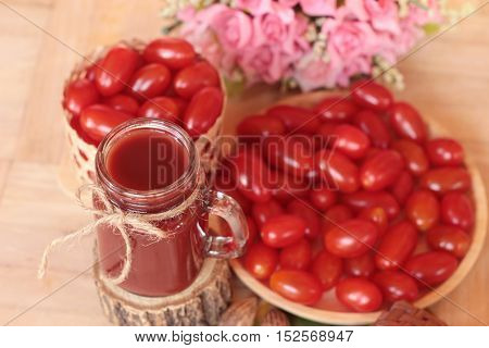 Tomato juice and fresh pear cherry tomatoes