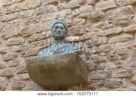 FLORENCE, ITALY - SEPTEMBER 2016 : Bust sculpture of Dante Alighieri's head on brick wall at Dante's House in Florence, Italy on September 21, 2016. Dante is Italian poet of the late Middle Ages