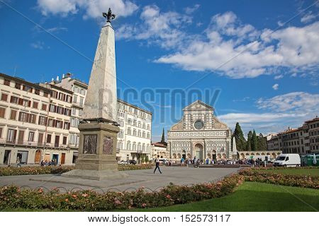 FLORENCE, ITALY - SEPTEMBER 2016 : Tourists at Basilica Santa Maria Novella church in Florence, Italy on September 21, 2016. It's the 1st great basilica, city's principal Dominican church in Florence