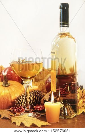 Festive table decorations with wine and candles for Thanksgiving