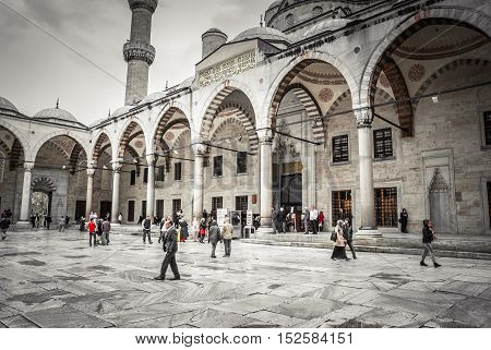 ISTANBUL, TURKEY - April 14, 2015: Tourists visiting Blue Mosque, Sultanahmet Camii.