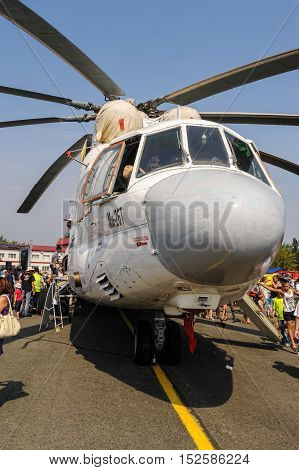 Tyumen, Russia - August 11, 2012: Air show On a visit at UTair in heliport Plehanovo. Visitors exploring the MI-26T helicopter