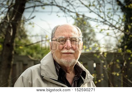 face portrait of a cheerful smiling senior man Quebec Canada