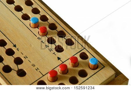 The beginning to victory. wooden Ludo game board.