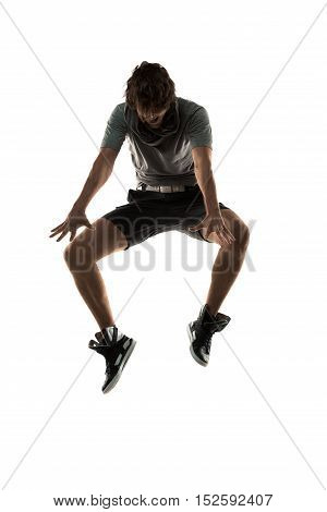 Young man dancer dancing funky hip hop rnb on isolated studio white background. Full length silhouette.