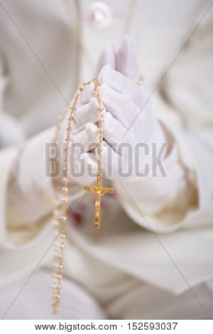 Hands With White Gloves Holding A Gold Rosary