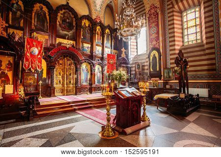 Vilnius, Lithuania - July 04, 2016: The Iconostasis And Ambon Of Three Steps Of Christian Orthodox Church Of Saint Nicholas.