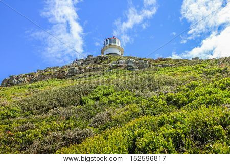 The old lighthouse at the top of Cape Point. The old Cape Point lighthouse is where visitors to the Cape of Good Hope Nature Reserve find Their best views of the southern oceans.