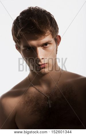 young athletic man on a white background