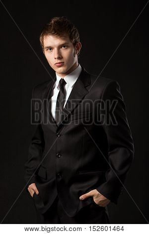 young business man on a black background