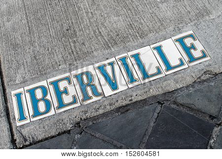 White tiles with blue lettering mark the sidewalks in the French Quarter of New Orleans, Louisiana