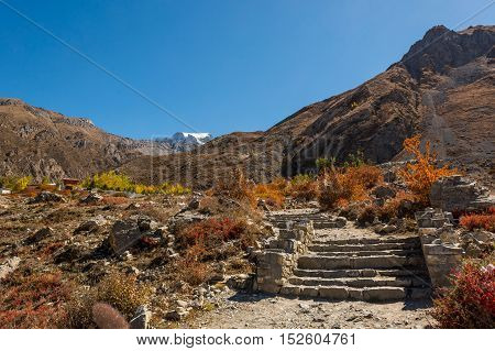 Steps leading towards a sacred place near Muktinath. Place of worship for Hindus and Buddhists.