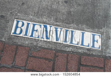 Dauphine Street marker in New Orleans, Louisisna - French Quarter.  These white tiles with blue letters mark the sidewalks.