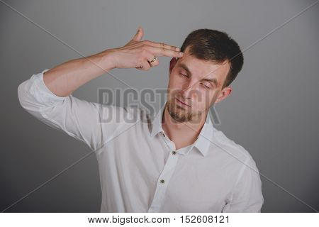 Young Man Pointing Finger Gun Gesture To Head
