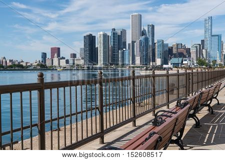 Benches along the Chicago pier with Chicago skyline in background