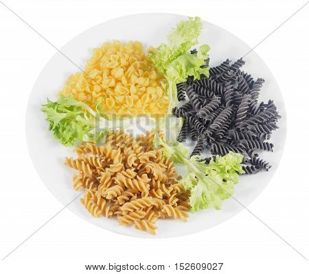 Gluten-free quinoa shells black beans rotini and chickpea rotini on a plate with leafy greens