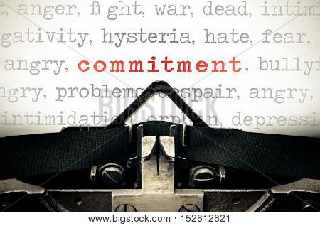 Typewritter With The Word Commitment