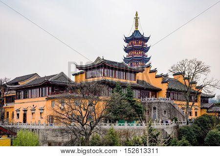 NANJING CHINA- MARCH 17: Jiming temple is an ancient temple which has recently been restored and now is now a popular tourist site on March 17 2016 in Nanjing.