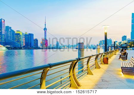 SHANGHAI CHINA - MARCH 28: Viewing platform on the Bund which is a popular tourist destination over looking the Pudong financial district of the city on March 28 2016 in Shanghai.