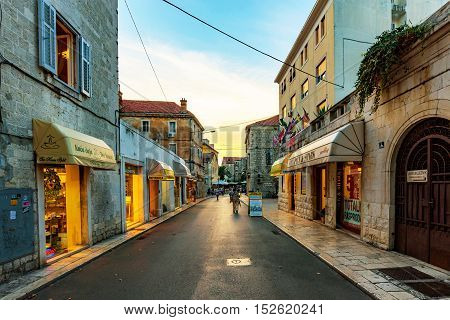 SPLIT CROATIA - SEPTEMBER 17: Downtown Split shopping area during the evening with old architecture and souvenir shops on Seteptember 17 2016 in Split