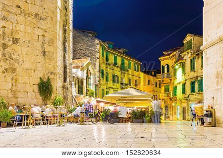 SPLIT CROATIA - SEPTEMBER 17: Old town center area at night with old architecture and restaurants on Seteptember 17 2016 in Split