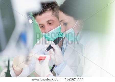 Dental Prosthesis, Dentures, Prosthetics Work. Dental Students While Working On The Denture, False T