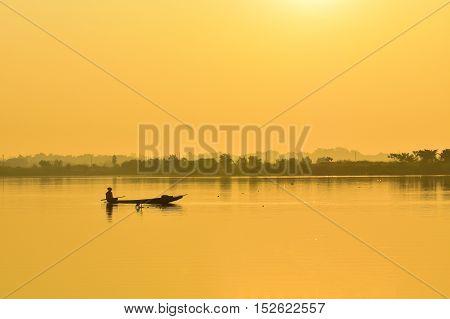 Fishermen fishing boat in the morning fog.