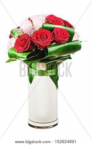 Colorful flower bouquet from roses in white vase isolated on white background.  Closeup.