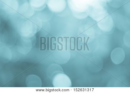 Blurred nature background. Backdrop with blue color and bright sun light. Summer holidays concept. bokeh background or Christmas background.