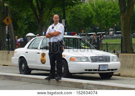 WASHINGTON DC - JUN 22, 2014: Policeman on duty near White House in Washington DC, USA.