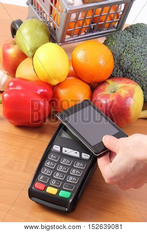 Payment Terminal And Mobile Phone With Nfc Technology, Fruits And Vegetables, Cashless Paying For Sh